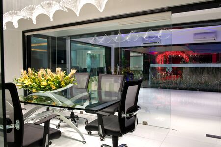 Interior of modern office with Conference room with glass walls and lounge with armchairs.