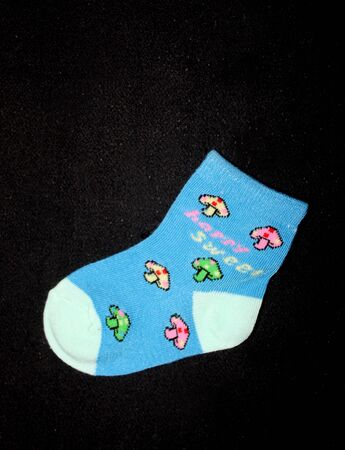 Collection of colorful baby socks, pair of cute baby socks isolated on back background Stockfoto