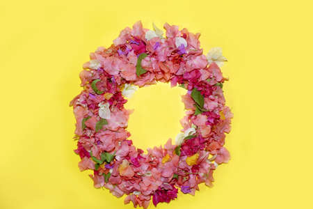 letter o flower alphabet, made from colorful bougainvillea flowers, wonderful flora letters for unique spring decorations and various creation ideas, greeting card design over on yellow background.