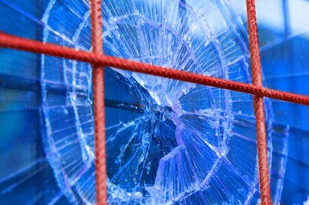 broken window with security steel bars photo