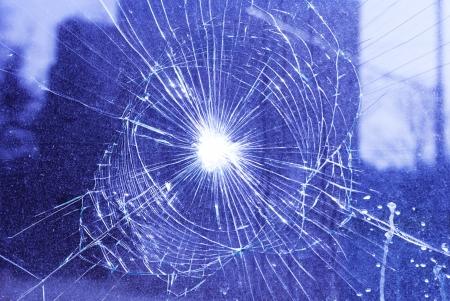 shattered: broken window with net shaped cracks