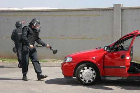 Police squad disarm a bomb inside a car of terrorists during military training in the city of Sofia, Bulgaria on Sep,11, 2007. Bomb squad robot