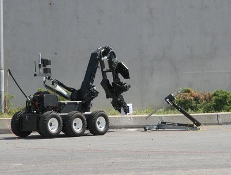 Bomb disposal robot disarm a bomb. Terrorism