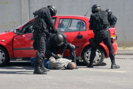 Police squad catch terrorists with car during exercise in the city of Sofia, Bulgaria � sep, 11,2007. Crime scene. Criminals.