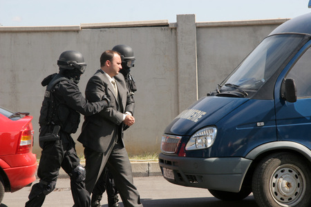 Police squad catch terrorists with car during exercise in the city of Sofia, Bulgaria – sep, 11,2007. Crime scene. Criminals.