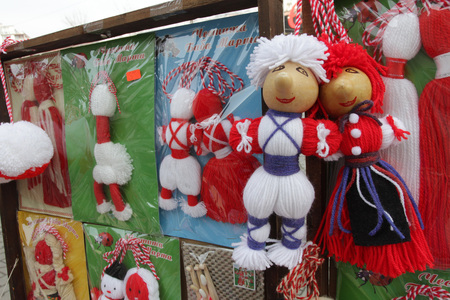 Red and white Martenitsi on outdoor market for martenici in Sofia, Bulgaria on Feb 8, 2016. Martenitsa or martenitza is given on 1st March as a symbol of health and prosperity. Red and white threads for health