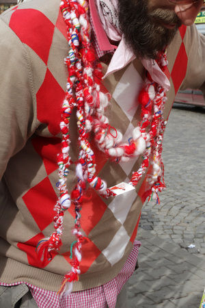Red and white Martenitsi on outdoor market for martenici. Martenitsa or martenitza is given on 1st March as a symbol of health and prosperity. Red and white threads for health. Stock Photo