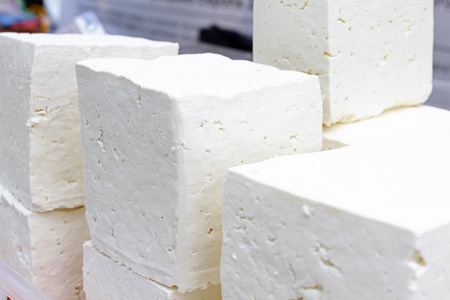 White brine cheese from cow, goat or sheep milk ready for eating . White brine bulgarian sirene ready for consummation. Traditional cheese from Balkans. Cubes of Bulgarian sirene white brine cheese