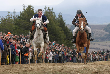 St. Todor �s day. Race with horses and horses pull carts with heavy logs on Todorov day in Bachevo, Bulgaria � march 7, 2009. Parade with horses on the top of the mountain. Horses and their owners participate in old but abusive and painful  ritual on Todo