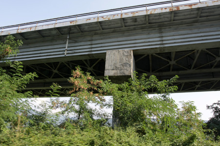 View under of Highway or Expressway overpass. Old construction highway. View under high bridge. Stock Photo