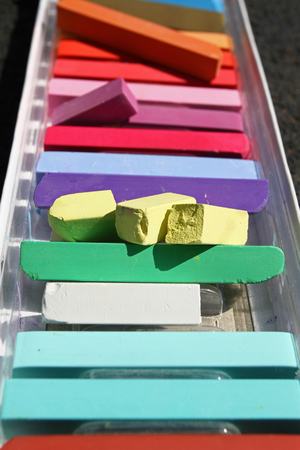Colored chalks. Colorful chalk pastels - education, arts, creative, back to school. Colour pastel chalk background. Color texture pattern. Vertical view. Group of color chalks. No sharpen.