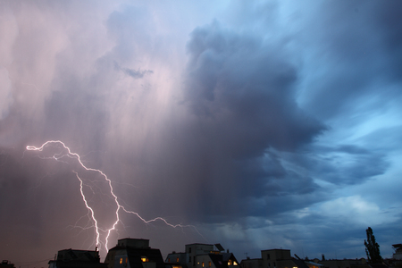 Thunderstorm lights. Bright lightning thunderstorms sparkle from the cloud. Dangerous electrical flash. Levin or scintillation for weather concept. Storm weather with heavy rain. Lightning bolt strikes with color clouds on the sky. Imagens