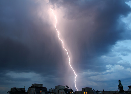 Thunderstorm lights. Bright lightning thunderstorms sparkle from the cloud. Dangerous electrical flash. Levin or scintillation for weather concept. Storm weather with heavy rain. Lightning bolt strikes with color clouds on the sky. Stock Photo
