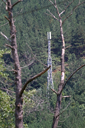 Telecommunication antennas for mobile operators in nature. Signal antenna tower outdoor in the mountain. Wireless Antennas in nature. Nature and human concept. Climate changes.