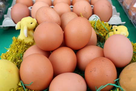 Close up of brown chicken eggs in carton box. Raw fresh chicken eggs