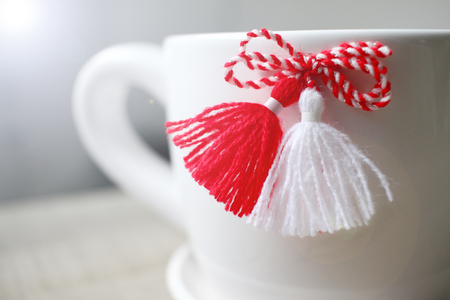 Bulgarian martenitsa or martisor. Traditional symbol of holiday baba Marta. National traditional symbol of red and white threads that people wears for good health. Baba Marta Day.