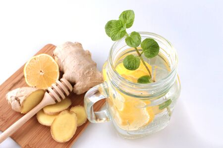 Glass of water, lemon, mint and ginger as background. Detox. Stok Fotoğraf