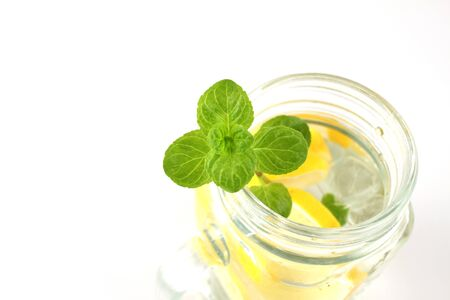Glass of water, lemon and mint. Detox.
