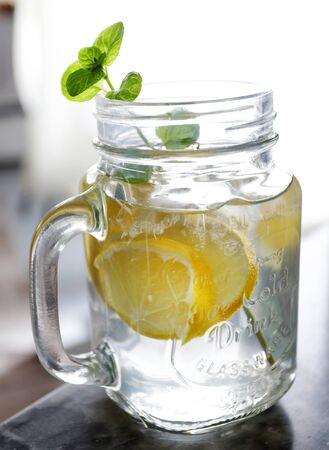 Glass of water, lemon and mint. Detox