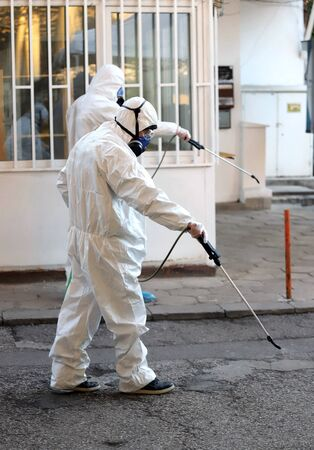 Disinfection and decontamination on a public place as a prevention against Coronavirus disease 2019, COVID-19. Foto de archivo