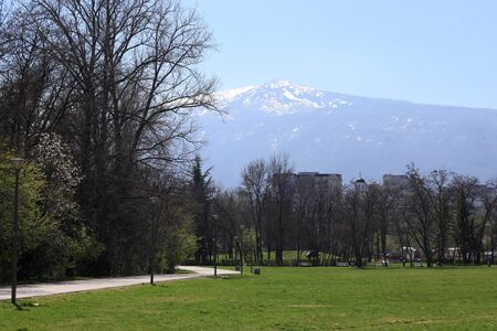 View of mountain Vitosha, Bulgaria. Empty South park with empty benches as prevention from coronavirus Covid-19 disease. Closed park for restriction during quarantine.