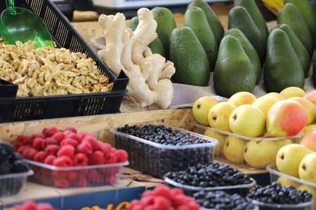 Colorful composition of fresh fruits and nuts in natural light for healthy eating and diet.