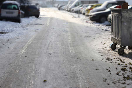 Uncleaned from snow, icy street. Slippery road in winter.