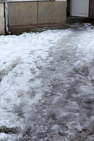 Uncleaned from snow, icy sidewalk.