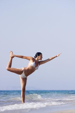 Joga on the beach Stock Photo