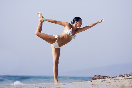 Joga on the beach Stock Photo
