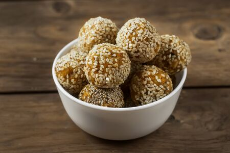 Raw healthy vegetarian food. Organic snack bites with dried apricots, dates, cashews and honey. Energy balls.