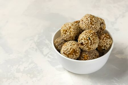 Energy healthy balls. Organic bites with dried apricots, dates, cashews, lemon and mint - vegan raw snack or meal.