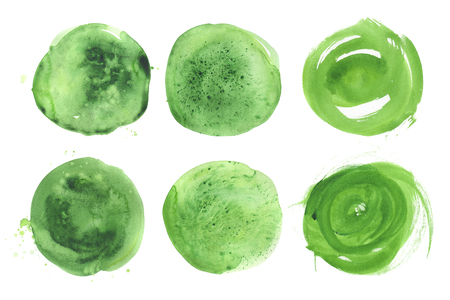 Set of hand drawn watercolor green spots. Collection salad round stains. Isolated on white background. Wet texture, grained paper. A vibrant saturated verdant tone. A kit of blotches.