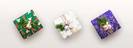 Three colored Christmas boxes with different decorations Zdjęcie Seryjne