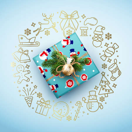 Christmas card with a blue box and a wreath of Christmas symbols
