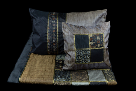 reflective: linens and pillows on a black background Stock Photo