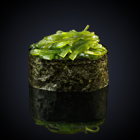 Gunkan Wakame Sarada on a black background