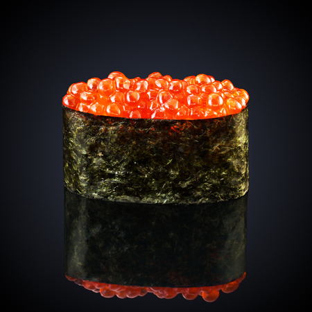 Gunkan Ikura with caviar on a black background Stock Photo