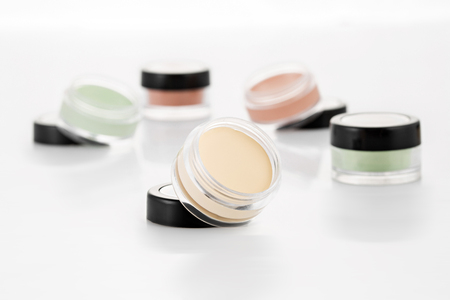 Color Cream Correctors palette, On isolated white background 스톡 콘텐츠