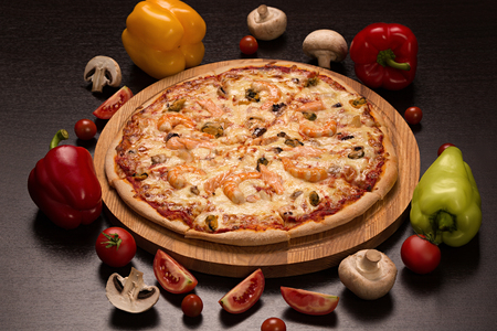 Pizza with seafood, mozzarella, mussels, octopus, squid, salmon and shrimp