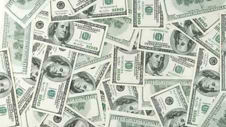 Wallpaper background American money  hundred dollar bill view from above. Many US 100 banknote.