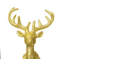 Closeup golden reindeer Christmas decoration  isolated on white background with copy space.