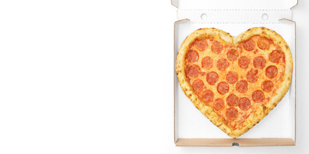 Pizza Heart Shaped top view in cardboard box for delivery Valentine Day with copy space isolated on white background. Pizza delivery. View from above. Valentines Day pizza concept.