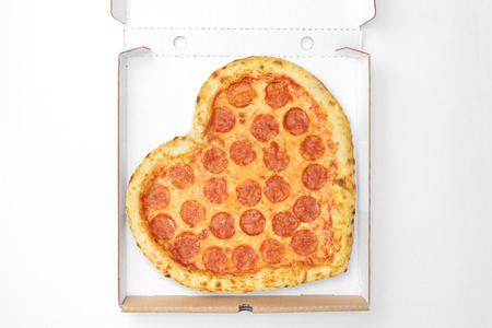 Pizza Valentine Day top view in cardboard box for delivery  isolated on white background. View from above. Pizza Heart Shaped.