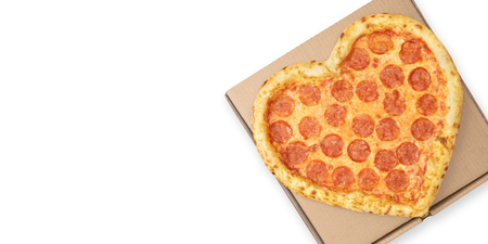 Pizza Valentine Day Heart Shaped top view on brown cardboard box for delivery fast food with copy space isolated white background. Pizza delivery. View from above.