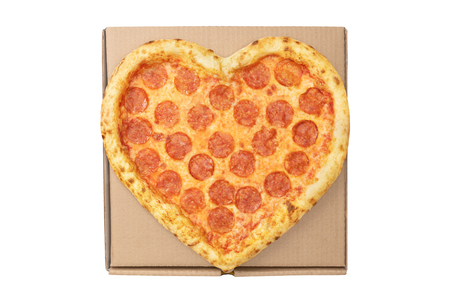 Pizza Valentine Day Heart Shape top view on brown cardboard box for delivery fast food isolated white background. Pizza delivery. View from above.