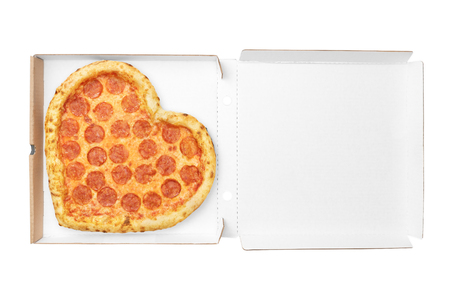 Pizza Heart Shape top view in cardboard box for delivery Valentine Day with copy space isolated on white background. View from above. Valentin Day concept 写真素材