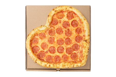 Pizza Heart Shape top view on brown cardboard box for delivery fast food isolated white background. View from above.