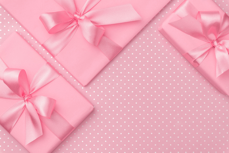 Gift box with pink ribbon bow on pink speckled background top view. Holiday concept, birthday gift, 8 march or Women day, gift box holiday Mothers day. Greeting card with copy space. Flat Lay 写真素材
