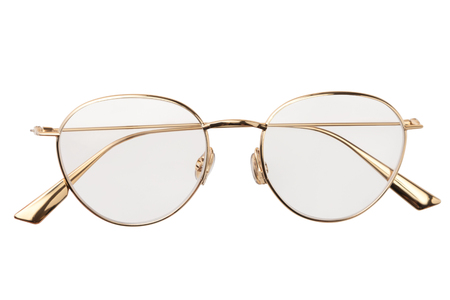 Gold glasses metal in round frame transparent for reading or good eye sight, top view isolated on white background.